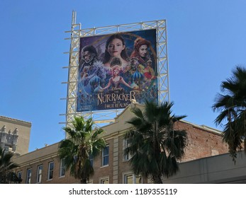 LOS ANGELES, SEP 22,2018: A billboard advertising the new Disney movie The Nutcracker and The Four Realms stands at the El Capitan above palm trees at Hollywood Boulevard at the Hollywood Walk of Fame