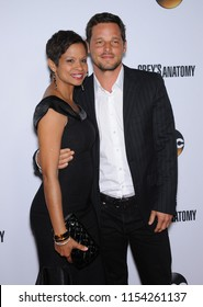 """LOS ANGELES - SEP 28:  Justin Chambers & Keisha Chambers arrives to the """"Grey's Anatomy"""" 200th Episode Party  on September 28, 2013 in Hollywood, CA"""