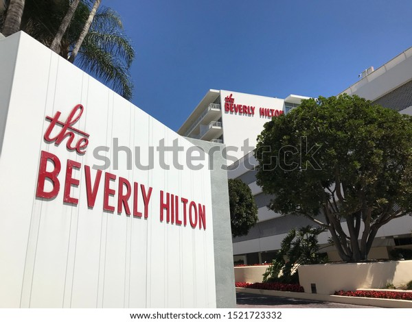 LOS ANGELES, Sep 7th, 2019: Beverly Hilton Hotel logo sign side angle close up with hotel facade logo in background. The hotel is famous for hosting the Golden Globes and other star-studded events.
