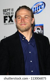 """LOS ANGELES - SEP 8:  Charlie Hunnam arrives at the """"Sons of Anarchy"""" Season 5 Premiere Screening at Village Theater on September 8, 2012 in Westwood, CA"""