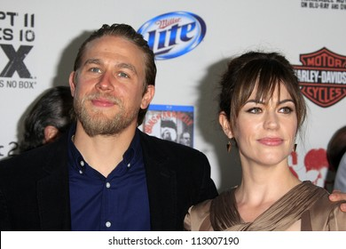 """LOS ANGELES - SEP 8:  Charlie Hunnam, Maggie Siff arrives at the """"Sons of Anarchy"""" Season 5 Premiere Screening at Village Theater on September 8, 2012 in Westwood, CA"""