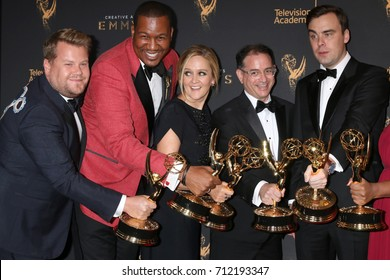 LOS ANGELES - SEP 9:  James Corden photobombing Samantha Bee Show Writing Team at the 2017 Creative Emmy Awards Press Room at the Microsoft Theater on September 9, 2017 in Los Angeles, CA