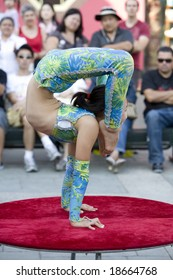 LOS ANGELES, SEPT 14:  Contortionist Enkhmurun, 11,  performing at the 2008 Moon Festival at the Los Angeles Chinatown.