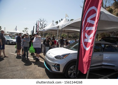 LOS ANGELES - SEPT 14: People line up to test drive Kia's EVs at a Drive Electric Week event in Los Angeles on Sept. 14, 2019. Kia's Niro EV is a popular electric CUV.