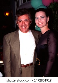Los Angeles - September 22, 1992: Singer Frankie Valli and his wife Randy leave the Peninsula Hotel.