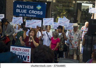 "LOS ANGELES - SEPTEMBER 22: Crowd hold placards at ""Big Insurance: Sick of It"" Rally at headquarters of Anthem Blue Cross in support of health care reform September 22, 2009 in Los Angeles."