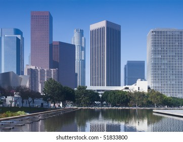 Los Angeles skyline in early morning with clear, blue sky.