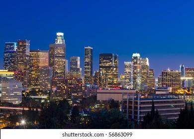 Los Angeles skyline at night with blue night sky.