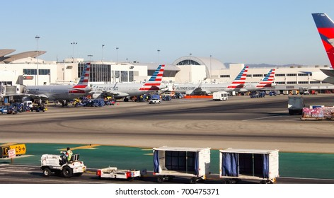 Los Angeles, USA - 25  September 2016: Aircraft lined up being prepared for flight at Los Angeles International (LAX) Airport