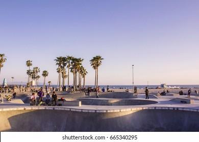 Los Angeles, USA - April 1, 2017: Venice Beach skatepark at sunset, LA, California. Soft light.
