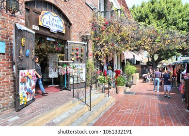LOS ANGELES, USA - APRIL 5, 2014: People visit Olvera Street in Los Angeles. Olvera Street is the oldest part of downtown LA. It is California State Historic Landmark since 1953.