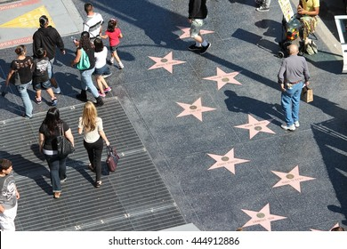 LOS ANGELES, USA - APRIL 5, 2014: People visit Walk of Fame in Hollywood. Hollywood Walk of Fame features more than 2,500 stars with inscribed celebrity names.