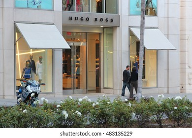 LOS ANGELES, USA - APRIL 5, 2014: Shoppers visit Hugo Boss store in Beverly Hills, Los Angeles. Hugo Boss is a German luxury fashion house 263 million EUR operating income in 2010.