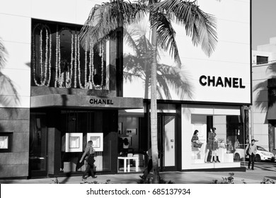 LOS ANGELES, USA - APRIL 5, 2014: Shoppers visit Chanel store in Beverly Hills, Los Angeles. The famous brand exists since 1909 and had 6.3 billion EUR revenue in 2012.