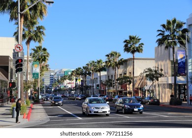 LOS ANGELES, USA - APRIL 5, 2014: People drive along Beverly Drive, Los Angeles. It's a major street of famous Beverly Hills district.
