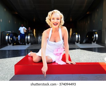 LOS ANGELES, U.S.A. - APRIL 8, 2014 : Marilyn Monroe statue on the Walk of Fame in Los Angeles. The Hollywood Walk of Fame stretches for 15 blocks of sidewalk on Hollywood Boulevard.