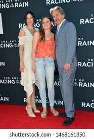 "LOS ANGELES, USA. August 02, 2019: Gary Cole, Guest & Mary Cole at the premiere of ""The Art of Racing in the Rain"" at the El Capitan Theatre.