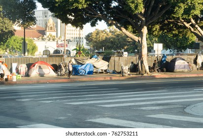 LOS ANGELES, USA - AUGUST 28, 2017: A row of tents and things of homeless people in Downtown LA. There are over 30 000 homeless living in the city of Los Angeles. Editorial.