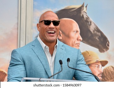 LOS ANGELES, USA. December 10, 2019: Dwayne Johnson at the handprint & footprint ceremony for Kevin Hart at the TCL Chinese Theatre.Picture: Paul Smith/Featureflash
