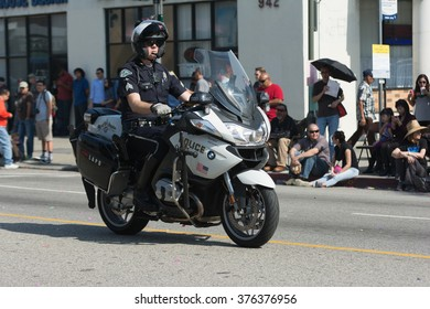 Los Angeles, USA - February 13, 2016: Motorcycle Police officer  during the 117th Golden Dragon Parade, celebrating Chinese New Year and the Year of the Monkey.