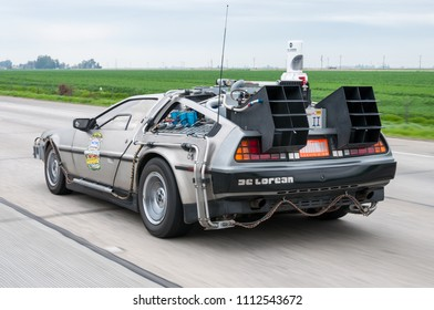 Los Angeles, USA- February 23, 2010: DeLorean a car (made of stainless steel) from Back To The Future movie trilogy traveling on Califronia's highway as a part of The Fireball Run Star Cars.