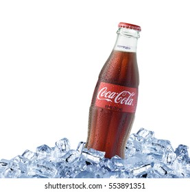 LOS ANGELES , USA - JANUARY 11 2017 Coca-Cola bottle with ice cubes isolated on white background. Coca Cola is the most popular carbonated soft drink beverages sold around the world