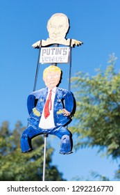 "Los Angeles, USA - January 19, 2019: A sign that reads, ""Putin's puppet.""  during 3rd Womens March in Los Angeles."