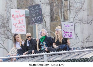 Los Angeles, USA - January 21, 2017:    Activist holds a signs during Women's March Los Angeles in Downtown LA.