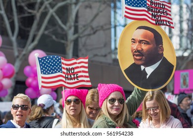 Los Angeles, USA - January 21, 2017:    Activists with American flags and image of Martin Luter King during Women's March Los Angeles in Downtown LA.