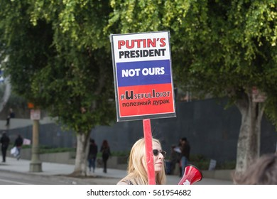 Los Angeles, USA - January 21, 2017:    Woman holding sign about Russian president during Women's March Los Angeles in Downtown LA.