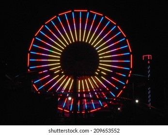 LOS ANGELES, USA - JANUARY 30, 2013: Pacific Park amusement park lights at night in Santa Monica Los Angeles California