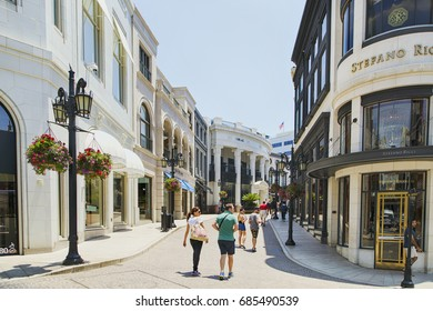 Los Angeles USA - July 1, 2017: Rodeo drive in Beverly Hills with people and stores.  Rodeo Drive is an affluent shopping district known for designer label and haute couture fashion.