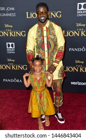 """LOS ANGELES, USA. July 10, 2019: Lance Gross & Berkeley Brynn Gross at the world premiere of Disney's """"The Lion King"""" at the Dolby Theatre.Picture: Paul Smith/Featureflash"""