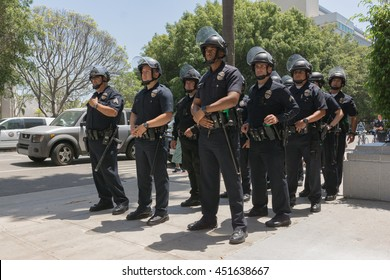 Los Angeles, USA - July 12, 2016 - Officers during march on City Hall following ruling on LAPD fatal shooting of African American female Redel Jones