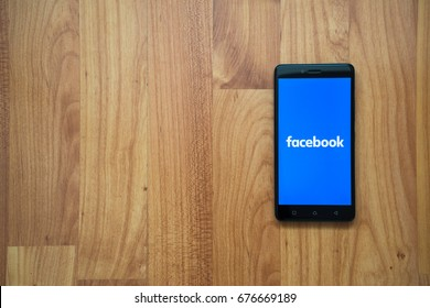 Los Angeles, USA, july 13, 2017: Facebook logo on smartphone screen on wooden background.