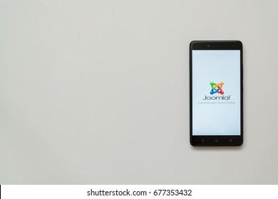 Los Angeles, USA, july 13, 2017: Joomla logo on smartphone screen on white background.