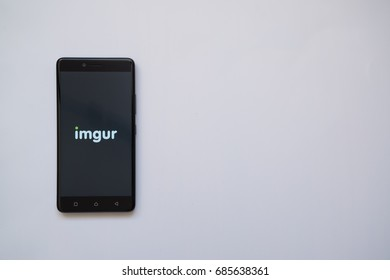 Los Angeles, USA, july 13, 2017: Imgur logo on smartphone screen on white background.