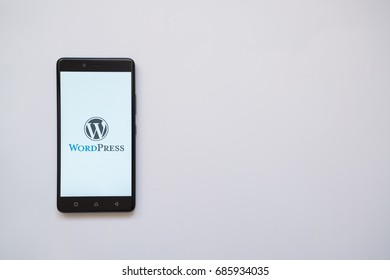 Los Angeles, USA, july 13, 2017: Wordpress logo on smartphone screen on white background.