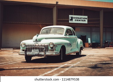 Los Angeles. USA. July 16, 2017. An old vintage car parked near Goodwill donation center. A car being donated.