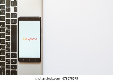 Los Angeles, USA, july 18, 2017: Aliexpress logo on smartphone screen placed on the laptop on white background.