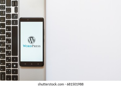 Los Angeles, USA, july 18, 2017: Wordpress logo on smartphone screen placed on the laptop on white background.