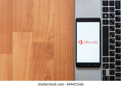 Los Angeles, USA, july 18, 2017: Microsoft office 365 on smartphone screen placed on the laptop on wooden background.
