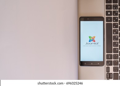 Los Angeles, USA, july 18, 2017: Joomla logo on smartphone screen placed on the laptop on white background.