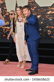 """LOS ANGELES, USA. July 23, 2019: Luke Hemsworth & Samantha Hemsworth at the premiere of """"Once Upon A Time In Hollywood"""" at the TCL Chinese Theatre.Picture: Paul Smith/Featureflash"""