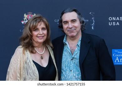 LOS ANGELES, USA - JUNE 09, 2019: Anna Giannotis (L), Bob Luna attend 13th Los Angeles Greek Film Festival 2019 Closing Night on June 09, 2019 in Egyptian Theatre in Los Angeles.