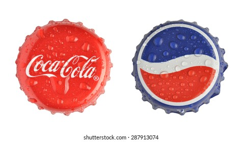 LOS ANGELES , USA - JUNE 3, 2015 Caps of Coca Cola and Pepsi with water drops isolated on white bacground