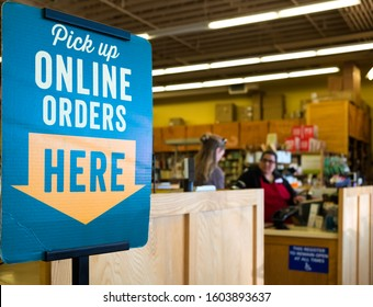 LOS ANGELES, USA, - MARCH, 27, 2018: 'Online Orders Pick Up' sign in a store in Los Angeles, California, USA.