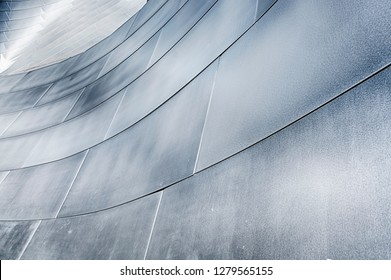 LOS ANGELES, USA - MARCH 5, 2018: A wall of metal panels on the exterior of the Walt Disney Philharmonic Hall designed by Frank Gehry reflects light in a shimmering pattern for an abstract background.