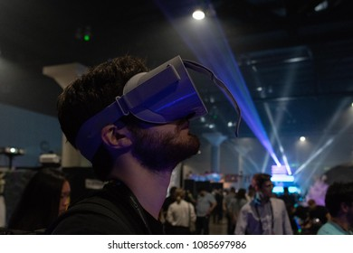 Los Angeles, USA - May 5, 2018: A man plays a video game using virtual reality glasses during VRLA - virtual reality exposition, at the Los Angeles Convention Center.