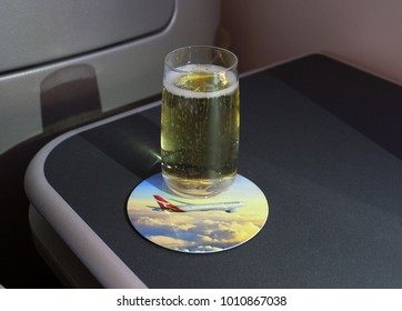 LOS ANGELES, USA TO MELBOURNE, AUSTRALIA FLIGHT – DECEMBER 17 2017: Qantas serves its business class passengers Champagne aboard flight QF96, served by its Boeing 787 Dreamliner aircraft.